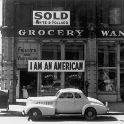 "Following evacuation orders, this store was closed.   The owner, a University of California graduate of Japanese descent, placed the ""I AM AN AMERICAN"" sign on the store front the day after Pearl Harbor.  Oakland, CA, April 1942.  Dorothea Lange. (WRA) Exact Date Shot unknown NARA FILE #:  210-G-2A-35 WAR & CONFLICT #:  772"